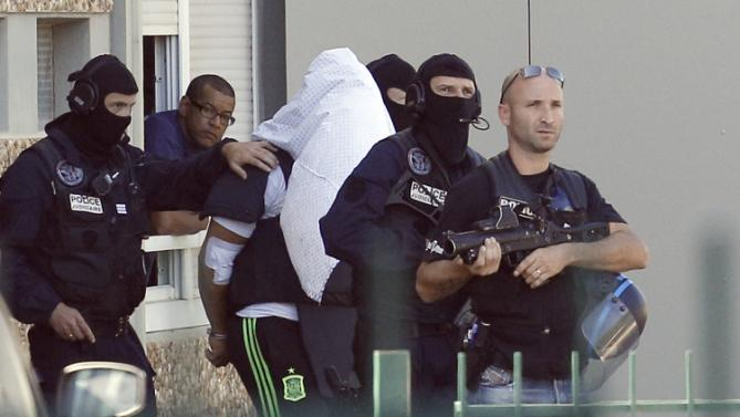 France's charges beheading suspect with terrorism charges