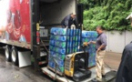 Coca-Cola Bottling Co. Consolidated Provides Drinking Water Bottles To The Flood Victims